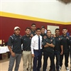Coach Pedro Cortes-Garcia with some of the soccer players